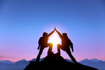 two man with success gesture  on mountain