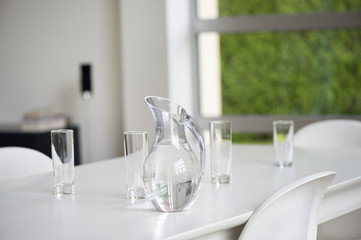Glasses and pitcher on a table