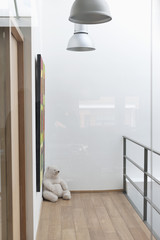 Teddy bear in the corner of a house