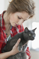 Close-up of a woman holding a black cat