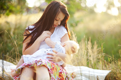 cute young mother with pretty infant son