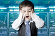 Surprised businessman child in suit with funny face