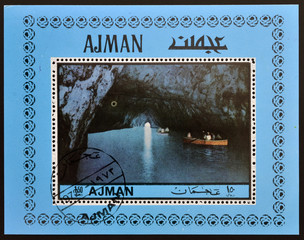 stamp printed in Ajman shows the Blue Grotto in Capri, Italy