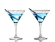 Blue cocktail in martini glasses isolated on white