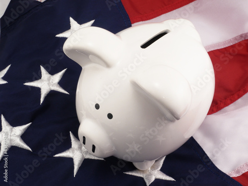 Piggy Bank Over American Flag