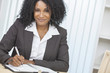 Beautiful African American Woman Businesswoman Writing