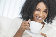 African American Woman Drinking Cup of Coffee or Tea