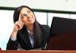Businesswoman at her desk having an idea
