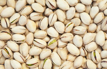 Healthy food, background. Shelled pistachios