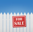 For sale sign on white wooden fence against blue sky