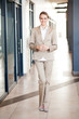 modern attractive young businesswoman full length portrait