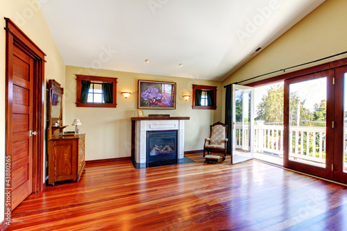 Room with beautiful chery hardwood floor and fireplace.
