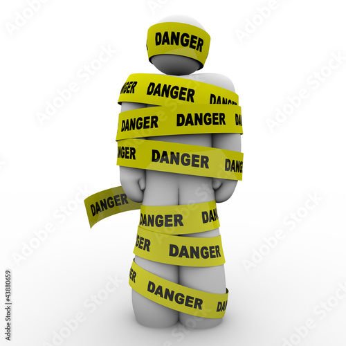 Person Wrapped in Yellow Danger Tape Warning Caution