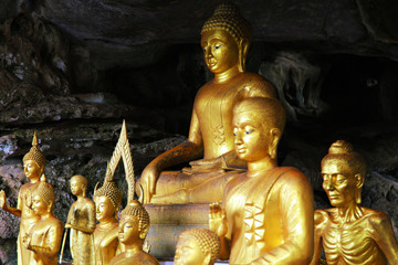 Sculptures of Buddha in cave