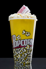 large popcorn bucket with movie passes