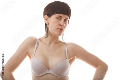 woman with piercings in white lingerie (white background)
