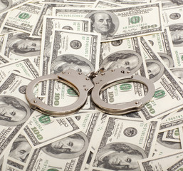 Handcuffs on money background   Criminal concepts