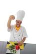 Koch mit Gemuese und Faust oben