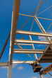 Workers install scaffolding platform of an industrial building