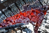 Decaying coals for cooking and a background