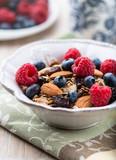 Muesli with fresh fruits, almonds and raisins