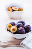 Fresh plums on  kitchen table