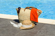 Bag with towel, sunglasses and a hat
