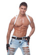 Muscular smiling sexy naked guy in blue jeans