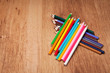 Assortment of colored pencils on wooden table