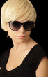 Woman with short blond hair wearing sunglasses