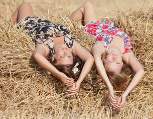 Two girls lying on hayloft