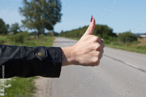 Hitchhiker Holding out his Thumb