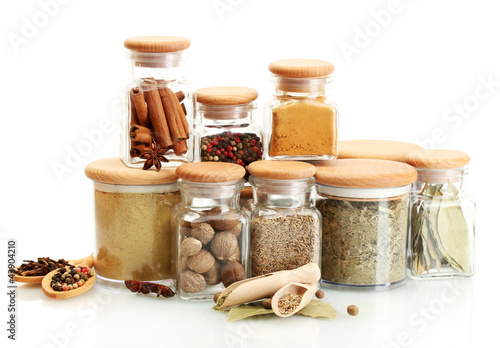 Fotobehang Kruiden 2 jars and wooden spoons with spices isolated on white