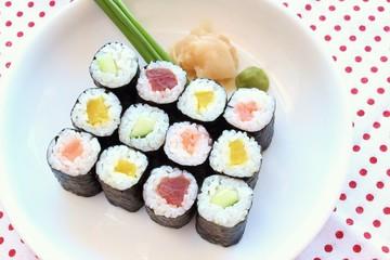 Hosomaki sushi  tuna, smoked salmon and vegetables inside