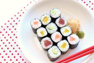 Hosomaki sushi  tuna, somked salmon and vegetables inside