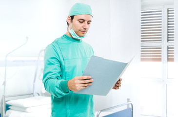 Surgeon reading a case history