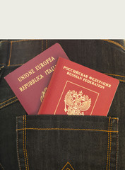 Italian and Russian passport in pocket jeans