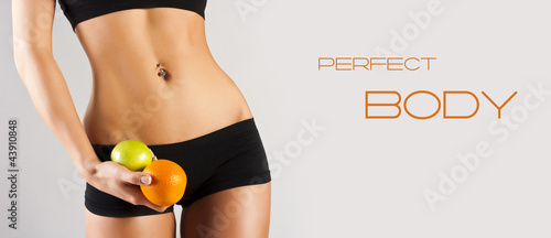 Concept of a healthy body. healthy lifestyle. Woman holding frui