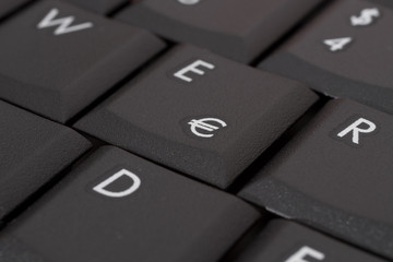 close-up of a computer keyboard key with an Euro sign