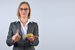 Businesswoman holding and showing a toy car on her hand