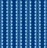 seamless pattern with lines of blue flowers on dark blue