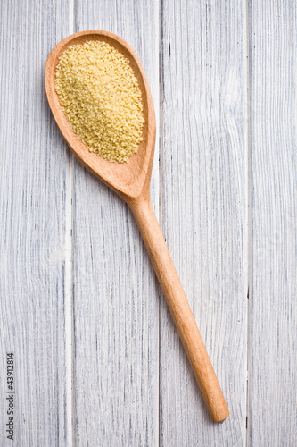 couscous in wooden spoon