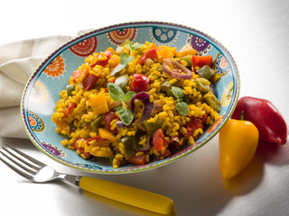 risotto with saffron and capsicum over steel background