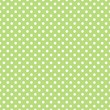 Seamless vector pattern with polka dots on green background