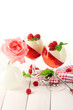 fruit jelly with raspberries in glasses on wooden table