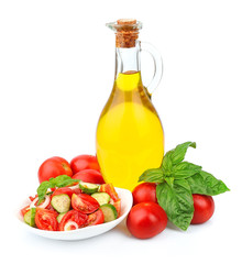 Bottle of oil with vegetables