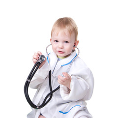 Little blond boy dressed as a doctor and with stethoscope
