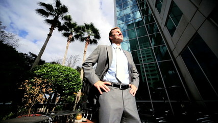 Satisfied Business Leader Outside Downtown Skyscrapers