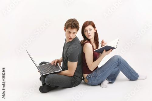 young couple with notebook and book