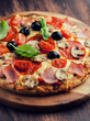 Pizza with mushrooms, salami and ham